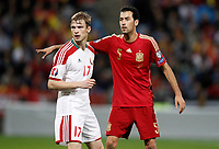 Spain's Sergio Busquets (r) and Belarus' Pavel Nekhaychik during 15th UEFA European Championship Qualifying Round match. November 15,2014.(ALTERPHOTOS/Acero)