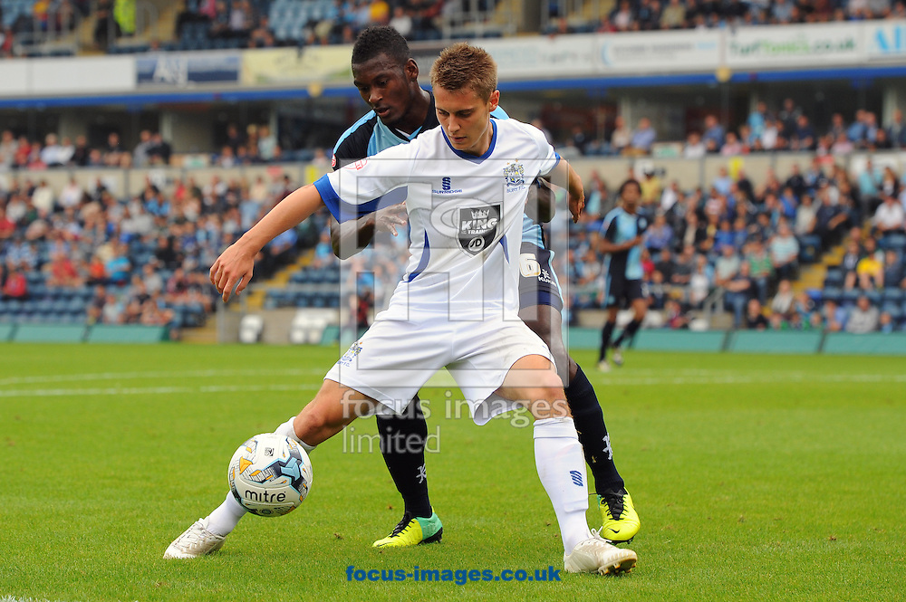 Danny Rose of Bury hold off Aaron Pierre of Wycombe Wanderers during the Sky Bet League 2 match at Adams Park, High Wycombe<br /> Picture by Seb Daly/Focus Images Ltd +447738 614630<br /> 06/09/2014