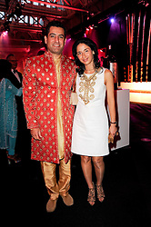 MR & MRS ENAYA TOLLAH at ARTiculate, Pratham UK Fundraising Gala held at The Old Billingsgate Market, City Of London on  11th September 2010 *** Local Caption *** Image free to use for 1 year from image capture date as long as image is used in context with story the image was taken.  If in doubt contact us - info@donfeatures.com<br /> MR & MRS ENAYA TOLLAH at ARTiculate, Pratham UK Fundraising Gala held at The Old Billingsgate Market, City Of London on  11th September 2010