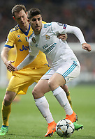 Real Madrid's Marco Asensio (r) and Juventus Football Club's Stephan Lichtsteiner during Champions League Quarter-Finals 2nd leg match. April 11,2018. (ALTERPHOTOS/Acero)