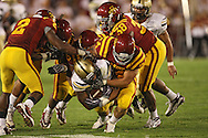 September 26, 2009: Army running back George Fletcher (28) is brought down by a host of Iowa State defenders during the second half of the Iowa State Cyclones' 31-10 win over the Army Black Knights at Jack Trice Stadium in Ames, Iowa on September 26, 2009.