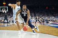 04 APR 2016: Forward Kris Jenkins (2) of Villanova University drives in to Forward Isiah Hicks (4) of the University of North Carolina during the 2016 NCAA Men's Division I Basketball Final Four Championship game held at NRG Stadium in Houston, TX. Villanova defeated North Carolina 77-74 to win the national title. Brett Wilhelm/NCAA Photos