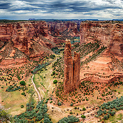 Canyon De Chelly National Monument's most distinctive feature is Spider Rock, a sandstone spire that rises 750 feet from the canyon floor.