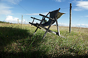 reclining wooden folding chair in the countryside