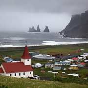 The church at Vík, the southernmost village in Iceland, sits high on a hill overlooking the town and its rugged coastline.