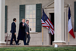 U.S. President Donald Trump, center, waves next to Emmanuel Macron, France's president, left, and Doug Bradburn, president and chief executive officer of George Washington's Mount Vernon, while touring outside the Mansion at the Mount Vernon estate of first U.S. President George Washington in Mount Vernon, Virginia, U.S., on Monday, April 23, 2018. As Macron arrives for the first state visit of Trump's presidency, the U.S. leader is threatening to upend the global trading system with tariffs on China, maybe Europe too. Photographer: Andrew Harrer/Bloomberg