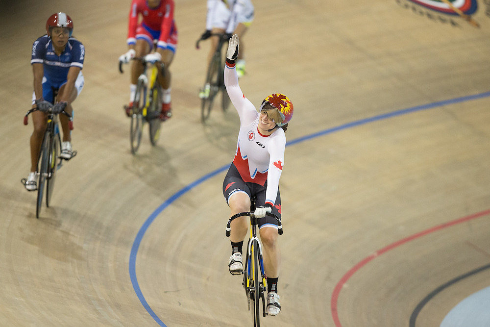 Monique Sullivan of Canada celebrates her gold medal win in the women's Keirin Cycling velodrome at the 2015 Pan American Games in Toronto, Canada, July 17,  2015.  AFP PHOTO/GEOFF ROBINS
