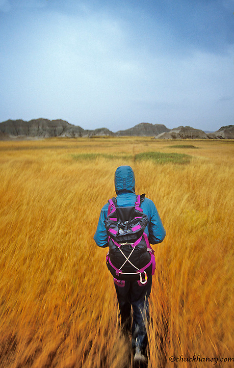Hiking in rainy weather at Badlands National Park in South Dakota model released