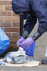 © Licensed to London News Pictures. 21/03/2018. Salisbury, UK. Police  in protective suits and gas masks are seen removing bags from the back of the Mill pub after Investigators from the Organisation for the Prohibition of Chemical Weapons (OPCW) have completed their work. Former Russian spy Sergei Skripal and his daughter Yulia were poisoned with nerve agent after visiting the Mill Pub in Salisbury. The couple where found unconscious on bench in Salisbury shopping centre. A policeman who went to their aid is currently recovering in hospital. Photo credit: Peter Macdiarmid/LNP