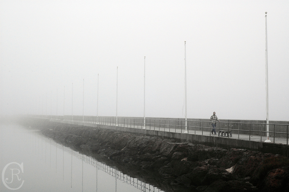 A Santa Barbara citizen takes a stroll along the Santa Barbara harbor in Santa Barbara, California