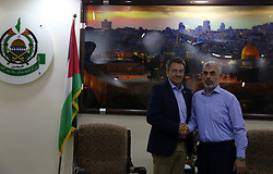 September 5, 2017 - Gaza, Palestinian Territories, Palestine - International Committee of the Red Cross (ICRC) President Peter Maurer (L) shakes hands with Hamas Gaza Chief Yehya Al-Sinwar during their meeting in Gaza City September 5, 2017. (Credit Image: © Majdi Fathi/NurPhoto via ZUMA Press)