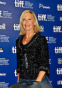 10.SEPT.2010. TORONTO<br /> <br /> OLIVIA NEWTON-JOHN ATTENDS THE SCORE: A HOCKEY MUSICAL PRESS CONFRENCE AT THE 35TH TORONTO FILM FESTIVAL IN TORONTO.<br /> <br /> BYLINE: EDBIMAGEARCHIVE.COM<br /> <br /> *THIS IMAGE IS STRICTLY FOR UK NEWSPAPERS AND MAGAZINES ONLY*<br /> *FOR WORLD WIDE SALES AND WEB USE PLEASE CONTACT EDBIMAGEARCHIVE - 0208 954 5968*
