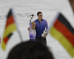February 15, 2018 - Pyeongchang, KOREA - Framed by German flags are Aljona Savchenko and Bruno Massot of Germany the winners in pairs free skating during the Pyeongchang 2018 Olympic Winter Games at Gangneung Ice Arena. The winners receive their medals later in the awards plaza ceremony. (Credit Image: © David McIntyre via ZUMA Wire)