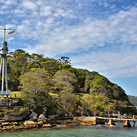 Bradleys Head Mast and Lighthouse in Sydney, Australia<br /> If you have extra time after visiting Taronga Zoo, consider taking a scenic hike along Athol Bay to the tip of Bradleys Head. There you will find the tripod foremast of the HMAS Sydney. This cruiser was launched in 1912 and served in WWI before being decommissioned and taken apart at Cockatoo Island in 1929. The monument honors Australian sailors lost at sea. You can also visit the Bradleys Head Fortification Complex, an amphitheater and this 1905 lighthouse. Keep following the waterside track &ndash; part of the North Shore Walk - to Taylors Bay and then Chowder Bay. All of these are part of the 970 acre Sydney Harbour National Park.