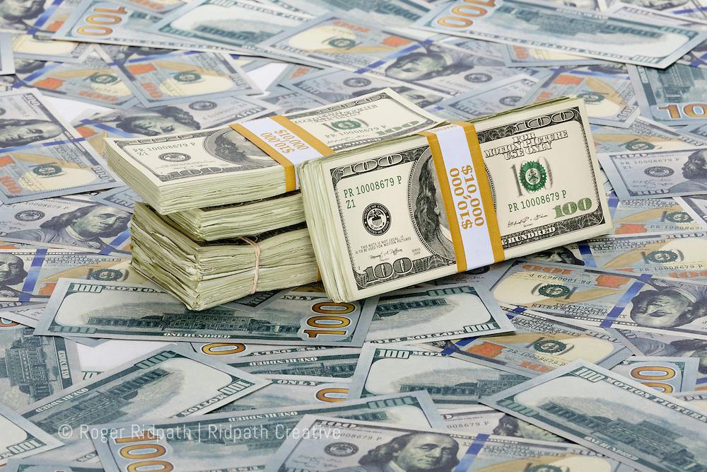 American $100 bills paper money with stacks