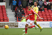 Stephen McLaughlin blocks Stefan Maierhofer during the Sky Bet Championship match between Nottingham Forest and Millwall at the City Ground, Nottingham, England on 31 January 2015. Photo by Jodie Minter.