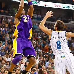 December 29, 2010; New Orleans, LA, USA; Los Angeles Lakers shooting guard Kobe Bryant (24) shoots over New Orleans Hornets shooting guard Marco Belinelli (8) during the first quarter at the New Orleans Arena.   Mandatory Credit: Derick E. Hingle