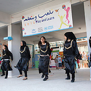 Girls performing n El-Buss refugee camp after a week of Play and Learn with Naba'a. Developmental Action Without Borders(Naba'a) work in Palestinian refugee camps across Lebanon to help children in the camps.  The camps are densely over-crowded and many of the children are 4th generation refugees living in Lebanon with no citizenship or rights and under immense pressure. Naba'a is a mix of Palestinians and Lebanese and aim to give children a sense of security and freedom to express their needs and rights.Naba'a operates in communities governed by a multitude of political parties and religious groups and Naba'a keeps a strict independed line from any affiliation with any groups.