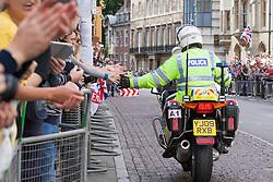Image ©Licensed to i-Images Picture Agency. 07/07/2014. Cambridge, United Kingdom. Tour de France Stage 3 Cambridge. Motorcycle cop slaps hands en-route<br /> Cambridge, City Centre. Picture by Terry Harris / i-Images