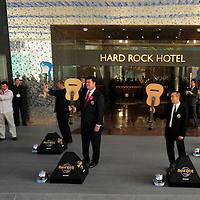 MACAU, CHINA - JUNE 01: (L-R first row)  President of City of Dreams Greg Hawkins, bussinesman James Packer, CEO of Melco Crown Entertainment Lawrence Ho and President and CEO of Hard Rock International Hamish Dodds prepare to smash guitars during the Hard Rock Hotel opening ceremony, as part of the acts of the opening of Packer and Ho's  'City of Dreams' casino on June 1, 2009 in Cotai, Macau. The new 420,000 square foot casino, built on marshland 9km from Macao's traditional casino district but over the road from the world's largest casino 'Sands Venetian Macao', hopes to lure customers to the new casino area. 'City of Dreams' will offer over 500 gambling tables alongside its 3 hotels, a shopping mall and digital fish which swim in an electronic aquarium know as 'The Bubble'.  Photo by Victor Fraile / studioEAST