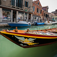 Samarco Par Forsa, wooden boat on a canal, Venice, Italy