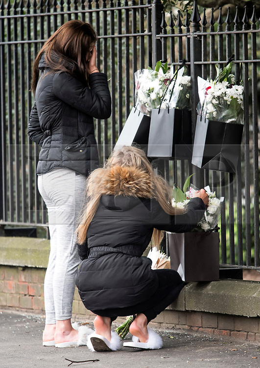 © Licensed to London News Pictures. 27/01/2018. London, UK. Flowers left by friends at the scene where three teenage pedestrians were killed near a bus stop in Hayes, West London after a black Audi car is believed to have collided with them. Police were called to the incident, on Friday night at 20:41hrs, close to the M4 Junction 4 following reports of a serious road traffic collision. The victims died at the scene - are all believed to be teenage males, aged approximately 16. Photo credit: Ben Cawthra/LNP
