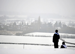 © Licensed to London News Pictures. 05/02/2012, Chinnor, UK. Two boys take in the view. People enjoy the snow in Chinnor, Oxfordshire today 05/02/12.  Heavy snow has fallen over many parts of the UK overnight. Photo credit : Stephen Simpson/LNP