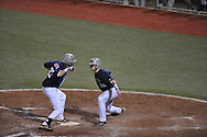 Ole Miss' Matt Snyder (33) celebrates a solo home run with teammate Will Allen (30) vs. LSU in Oxford, Miss. on Friday, May 4, 2012.  LSU won 4-3 in 13 innings.