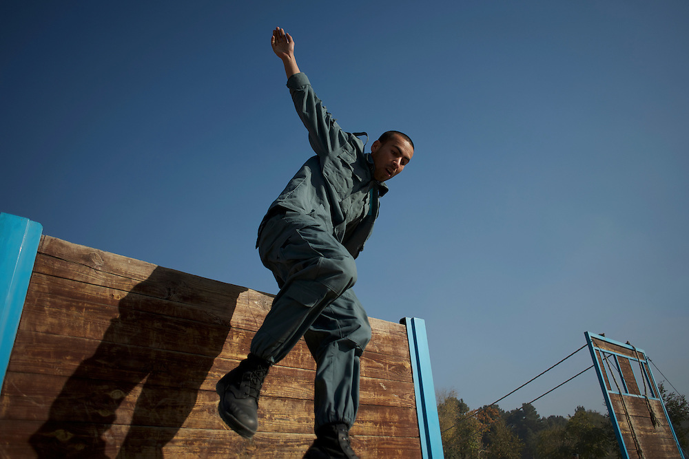 An Afghan National Police (ANP) cadet jumps an obstacle during morning endurance exercises at the Afghan Nacional Police Academy in Kabul.