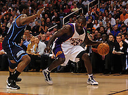 Mar. 19 2010; Phoenix, AZ, USA; Phoenix Suns guard Jason Richardson (23) dribbles the ball against Utah Jazz guard Wesley Matthews (23) during the first half at the US Airways Center.  The Suns defeated the Jazz 110-100. Mandatory Credit: Jennifer Stewart-US PRESSWIRE.