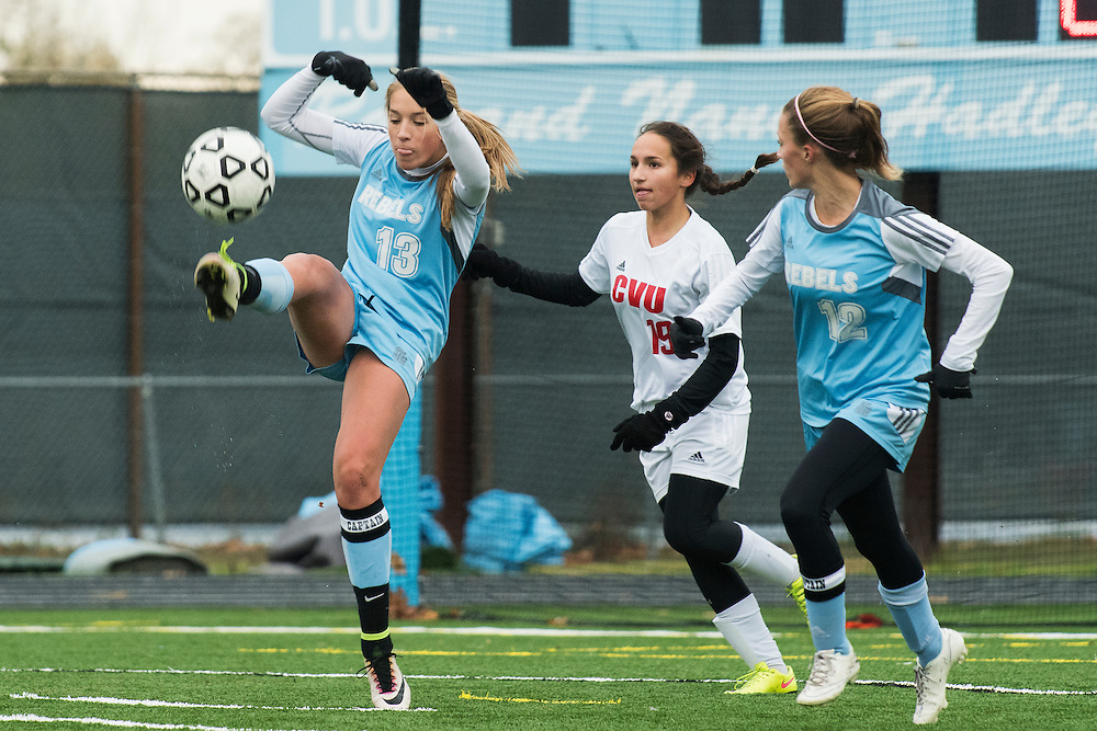 South Burlington's Annika Nielsen (13) kicks the ball during the girls high school playoff game between the Champlain Valley Union Redhawks and the South Burlington Rebels at South Burlington High School on Saturday afternoon October 29, 2016 in South Burlington. (BRIAN JENKINS/for the FREE PRESS)