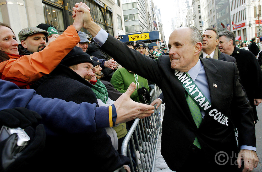 Presumptive US presidential candidate Rudolph Giuliani shakes hands with the crowd while marching in the 246th annual St. Patrick's Day parade in New York, York on Saturday 17 March 2007. The annual event is the largest St. Patrick's Day Parade in the world.
