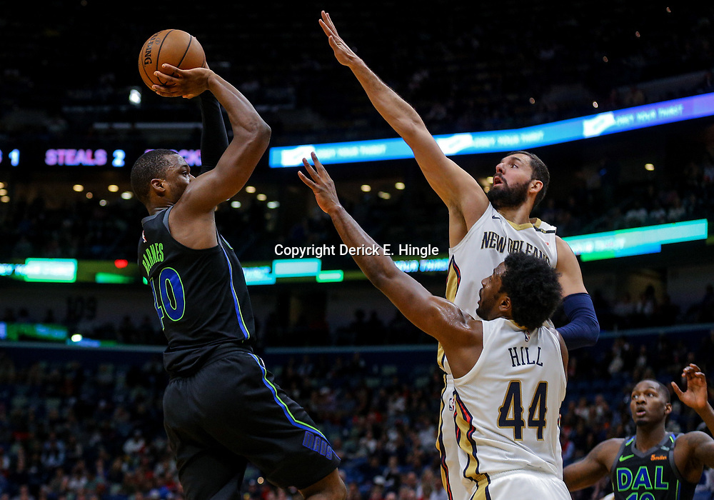 Mar 20, 2018; New Orleans, LA, USA; Dallas Mavericks forward Harrison Barnes (40) shoots over New Orleans Pelicans forward Nikola Mirotic (3) and forward Solomon Hill (44) during the second quarter at the Smoothie King Center. Mandatory Credit: Derick E. Hingle-USA TODAY Sports