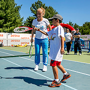August 23, 2016, New Haven, Connecticut: <br /> Svetlana Kuznetsova of Russia plays tennis with a kid during a Latino Day clinic at the AETNA Fit Zone during Day 5 of the 2016 Connecticut Open at the Yale University Tennis Center on Tuesday, August  23, 2016 in New Haven, Connecticut. <br /> (Photo by Billie Weiss/Connecticut Open)