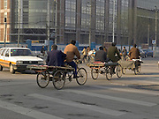 bicycle carts crossing a road Beijing China