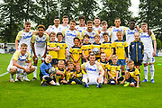 Leeds United players and Tadcaster Albion mascots during the Pre-Season Friendly match between Tadcaster Albion and Leeds United at i2i Stadium, Tadcaster, United Kingdom on 17 July 2019.