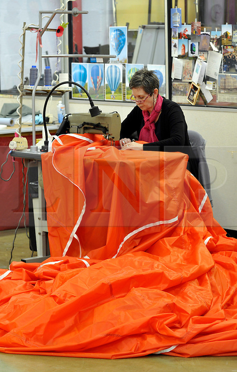 © Licensed to London News Pictures. 28/02/2012. Cameron Balloons factory in Bedminster, Bristol, manufactures hot air balloons for clients around the world.  They are seeking sponsorship for this year's Bristol International Balloon Fiesta which takes place in August..Photo credit : Simon Chapman/LNP