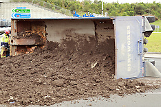 Auckland-Truck load of dirt rolls on off ramp, Brigham Creek Road