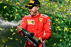 March 25, 2018 - Melbourne, Victoria, Australia - Scuderia Ferrari driver SEBASTIAN VETTEL, of Germany, celebrates celebrates on the podium after winning the 2018 Formula One Australian Grand Prix, at Albert Park. (Credit Image: © Hoch Zwei via ZUMA Wire)