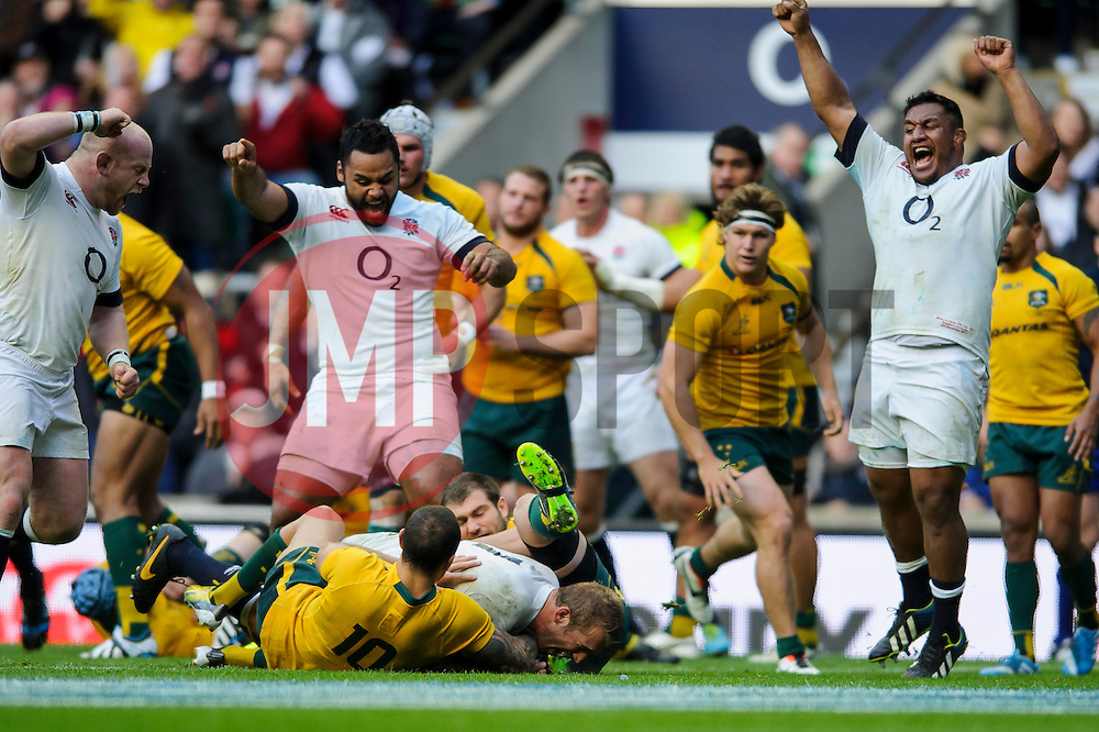 England Number 8 (#8) Billy Vunipola (London Wasps)  and Prop (#1) Mako Vunipola (Saracens) celebrate as England Flanker (#7) Chris Robshaw (Harlequins, capt) dives on Australia loose ball to score a try during the second half of the match - Photo mandatory by-line: Rogan Thomson/JMP - Tel: Mobile: 07966 386802 02/11/2013 - SPORT - RUGBY UNION -  Twickenham Stadium, London - England v Australia - Cook Cup - QBE Autumn Internationals.