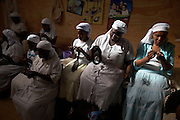 "The ""Crochet Sisters"" working on the MAX&Co. range in Nairobi, Kenya, on Tuesday, Jan. 13, 2009. The group is made up of some 200 women from Zimbabwe many of whom have fled that country and are now refugees. They are members of the Church of the Gospel of God and are true experts in the art of crochet, producing hand-made one-of-a-kind shoulder-bags, cases and scarfs."