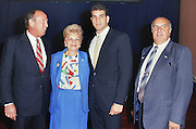 NFL Commissioner Pete Rozelle (left) poses for a photo with Tampa Bay Buccaneers quarterback Vinny Testaverde (third from left) and his parents (Josie and Al) after Testaverde is selected as the number one overall draft pick during the 1987 NFL Draft on April 28, 1987 in New York. (©Paul Anthony Spinelli)