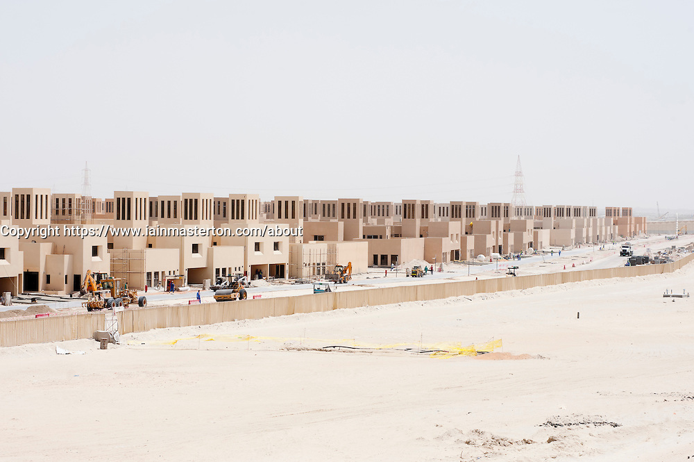 New housing development with traditional style houses  in desert in abu Dhabi UAE