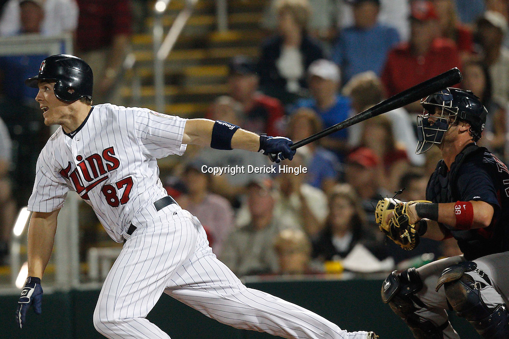 February 27, 2011; Fort Myers, FL, USA; Minnesota Twins center fielder Joe Benson (87) connects on a three run triples during a spring training exhibition game against the Boston Red Sox at Hammond Stadium.  Mandatory Credit: Derick E. Hingle