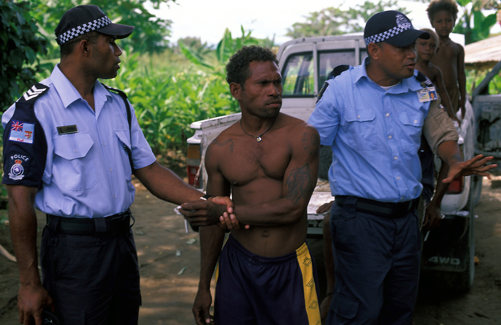Sgt. Luke Qerewaqa (Fiji) & Sgt. Godfrey Abiah (RSIP) attend a dispute between neighbours at Burns Creek aka Dark Corner, an area notirous for crime and outbreaks of violence. Honiara, The Solomon Islands