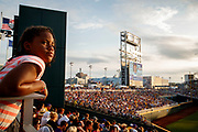 Alecia Lathan, 10, of Omaha watches the LSU vs. Florida baseball game on Tuesday, June 27, 2017 during Game 2 of the Championship Series  of the College World Series at TD Ameritrade Park in Omaha.