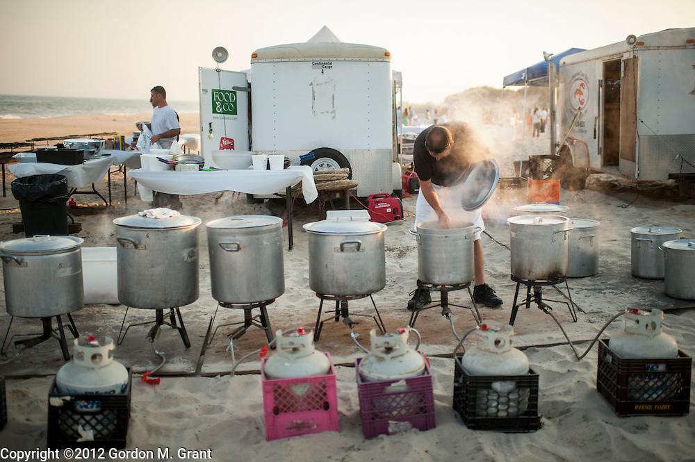 Sagaponack, NY - 6/29/12 - Pots of boiling water to cook lobsters and shellfish during a clambake at Sagg Main Beach in Sagaponack, NY June 29, 2012.     (Photo by Gordon M. Grant)