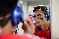 Folsom Bulldogs Tanner Ward (22), applies face paint as he gets ready inside the locker room before the game as the Folsom High School Bulldogs varsity football team hosts the Central High School Grizzlies in the CIF NorCal Division I-AA title game, Friday Dec 8, 2017. The winner of this game will face the CIF SoCal winner in the State Championship game at Sacramento State, Friday Dec 15th.<br /> photo by Brian Baer
