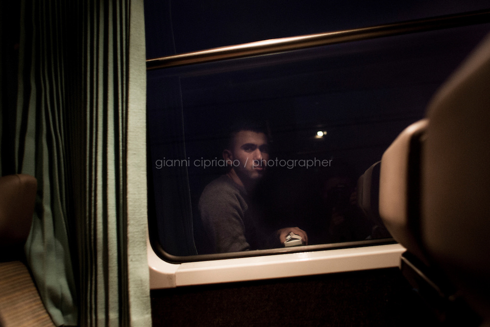 EVRY, FRANCE - 19 NOVEMBER 2014: A Syrian refugee is here onthe Night Intercity Train from Nice to Paris, in Evry, France, on November 19th 2014.<br /> <br /> After crossing the Italian-French border, migrants take the train to Paris. Some stop in Paris, but the majority continues the journey to Calais (before arriving in London), while others go to countries such Germany, the Netherlands, and Sweden.