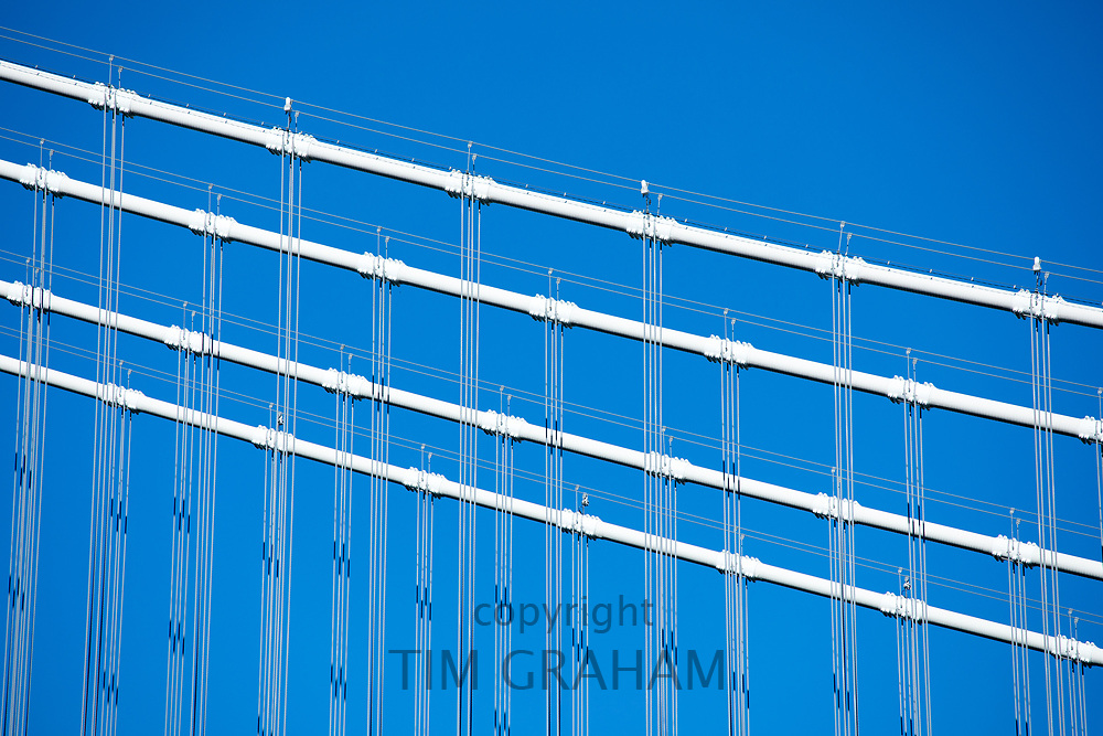Wire supports and cables of Manhattan Bridge viewed against blue sky, New York City